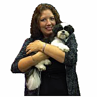 instructor renee white holding small dog with white background